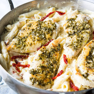 Basil Pesto Chicken with Alfredo Penne and Sun Dried Tomatoes.