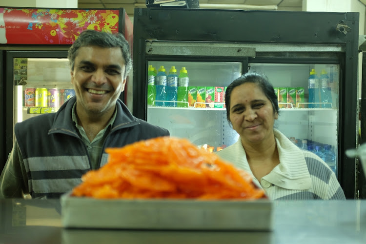 Jaya and Pragnesh Bhatt  with some of the delicacies on offer in their  vegetarian takeaway, Little Surat.