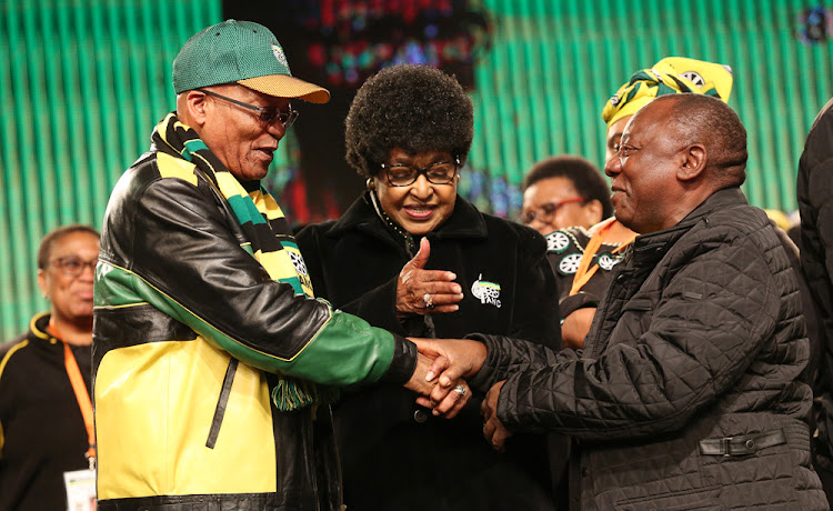 ANC stalwart Winnie Madikizela-Mandela gets ANC President Jacob Zuma and his deputy Cyril Ramaphosa to hold hands before the start of the ANC Policy conference at Nasrec on 6 July 2017.