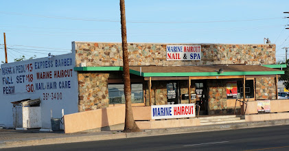 "Photo: Twentynine Palms is near a few military bases, thus establishments such as this.  ""Marine Haircut Nail & Spa"" are not words I would expect to see together in the name of a business!"