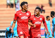 Mothobi Mvala of Highlands Park celebrates with teammate Lesenya Ramoraka of Highlands Park after scoring during the Absa Premiership match between Highlands Park and Polokwane City at Makhulong Stadium on September 29, 2019 in Johannesburg, South Africa.