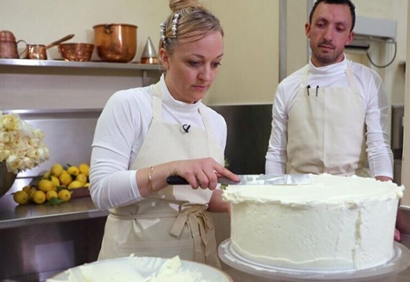 Claire Ptak hard at work on Prince Harry and Meghan Markle's wedding cake in the kitchens at Buckingham Palace.
