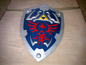 Photo: Hylian Shield ordered from the internet. Wire reinforced fiberglass. Weighs about 8 lbs.
