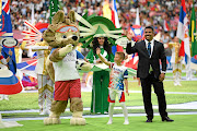 Former Brazil player Ronaldo cheers the fans with the 2018 Fifa World Cup Russia mascot Zabivaka the Wolf prior to the opening  match  in Moscow this week.