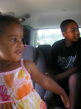 Photo: Kaleya and Kamau in the car as we get ready to get on the road.