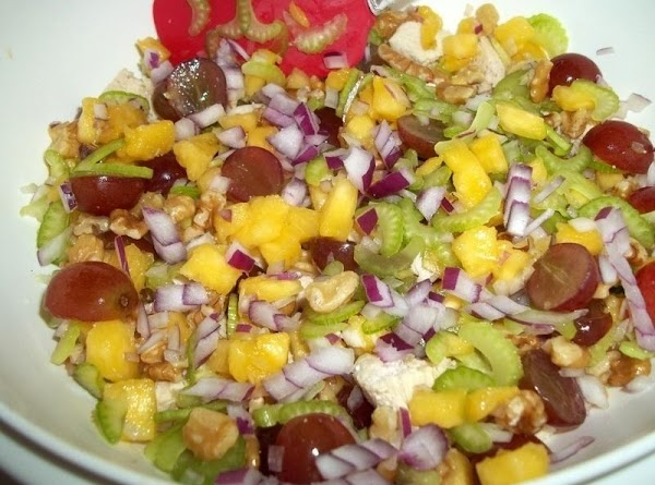 In a large bowl; add pineapple, celery, onion, grapes, parsley and toss to blend.