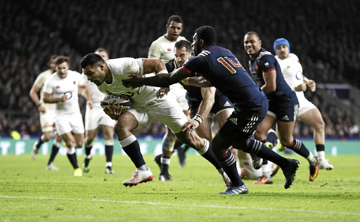 Fresh off the bench: England's Ben Te'o beats the France defence to go over for the try that settled the match. Picture: REUTERS