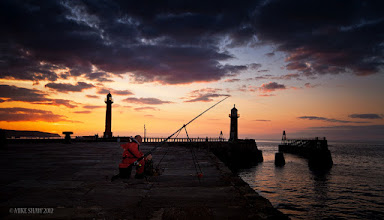 Photo: Father And Son  While on a weekend break in Whitby with my wife we went to the harbour to catch what turned out to be a stunning sunset, while there we came across this father and son out fishing, I asked if I could take their photograph as part of the landscape and they were good with it. It was only when I came to edit the image did I see that they were both looking at something in the sky, to this day I have no idea what caught their attention.  I love the intimacy of the moment.  Good Morning Googlers :)