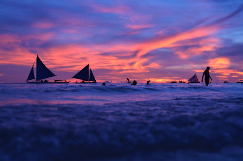 sunset by Philip Familara - Landscapes Sunsets & Sunrises ( blue sky, boracay, sunsets, sunset, boats, sundown, sail, sailboat, boat, philippines, island )