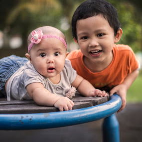 Lovely sibling by Mohd Nazmie Ab Malek - Babies & Children Child Portraits ( fashion, park, kids, siblings, love, girl, family, dress, lifestyle, outdoor, baby, boy, light )