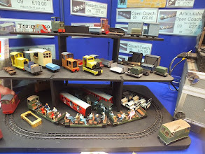 Photo: 022 And some more of the fascinating and attractive 09 Minimum Gauge Models range. The yellow Simplex loco in the centre of the middle shelf is a highly modified Wrightlines 0-16.5 model that has been made into an 09 loco by Andy Greenslade .