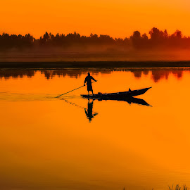 Fishing Boat At Sunset by Mamunur Rashid - Landscapes Waterscapes ( rivers, sunlight, sunset, riverside, sunny,  )