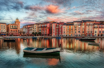 Photo: A Lonely Boat Floats Across the Pastels... (The Bay at Portofino)  This isn't really Portofino, but it sure does look like it, eh? We might even make the case that it is more pretty than the real Portofino! This is a beautiful resort in Orlando, over at Universal Studios.  From the blog at www.stuckincustoms.com