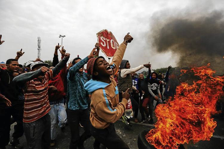 THE FACE OF DESPAIR: Residents of Eldorado Park in southern Johannesburg protest to demand houses and land as anger engulfs poor South Africans whose upliftment was abandoned by the ANC in favour of looting state resources to enrich an elite.