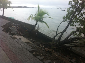 Photo: Sidewalk collapsed from the force of the waves in the storm