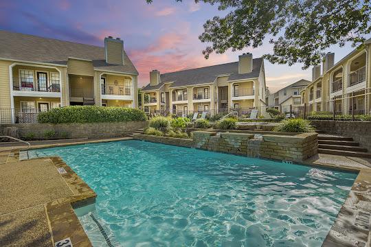 The Arbors on Oakmont apartment swimming pool at dusk