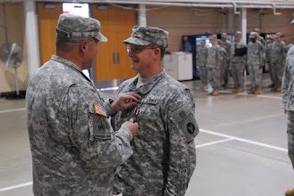 Photo: CSM Gery Thesing of the Minnesota National Guard's 34th Combat Aviation Brigade, 34th Infantry Division, was awarded the Meritorious Service Medal by 34th CAB commander COL Michael Huddleston during his retirement ceremony, May 21. The incoming CSM is CSM James Kampsen. Photo by Sgt. Nicholas Olson, 34CAB PAO