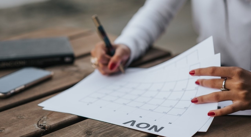 woman marking her calendar to schedule her apartment move