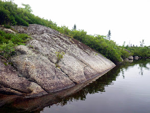 Photo: Going south on the west side of the lake, here a view back. The bushy vegetation growing in crevices and more nearly level areas where some soil accumulates is mostly Huckleberry, some Rhodora, Lambkill, Canada Holly, Bayberry and in wettest spots, Mountain Holly and Sweet Gale.