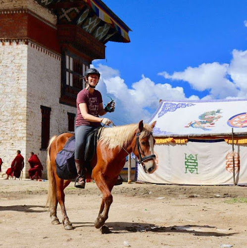 Horse riding in bhutan with monks