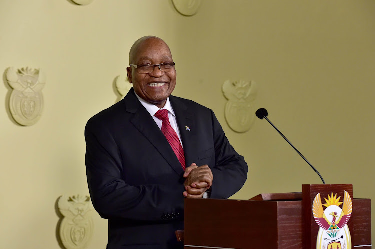 Jacob Zuma smiles ahead of his televised resignation as South African president on Wednesday night.