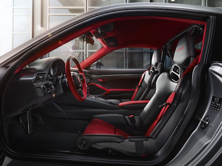 The interior features Alcantara and carbon weave. Picture: PORSCHE