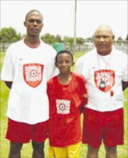 GLORY ROAD: Young Mogorosi Mmethi who was selected as an outstanding player at the Shona Khona regional camp is pictured with Gideon Noge, left, and Simon Mahlangu. 04/05/08. © Sowetan.