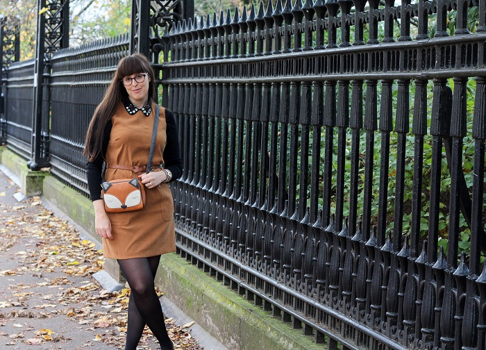 Dark shirt worn under suedette pinafore