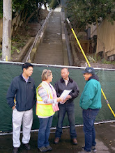 Photo: KZ Tile representatives (Kai on left, Michael on right) and San Francisco Department of Public employees (Jody and Khun in center) meet on October 24, 2013 for the final onsite inspection clearing the way for installation of the 148-step Hidden Garden Steps (16th Avenue, between Kirkham and Lawton streets in San Francisco's Inner Sunset District) ceramic-tile mosaic designed and created by project artists Aileen Barr and Colette Crutcher. For more information about this volunteer-driven community-based project supported by the San Francisco Parks Alliance, the San Francisco Department of Public Works Street Parks Program, and hundreds of individual donors, please visit our website at http://hiddengardensteps.org.