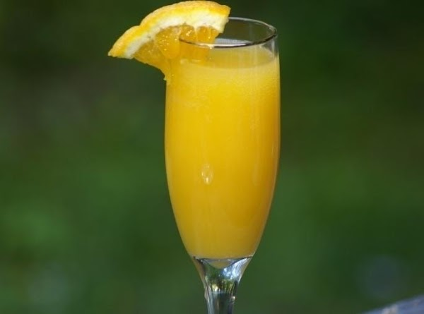 Combine sparkling wine, orange and pineapple juices in a 64 ounce pitcher. Stir well,...