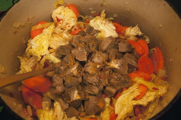 Add the beef, and continue to simmer for an additional 5 minutes.