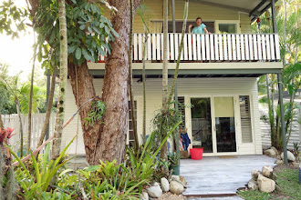 Photo: Our digs in Port Douglas for 11 nights or so--Artists' Treehouse. Quirky, roomy, stuffed w/ furniture and art all over the walls. Nice street 2 blocks from beach.