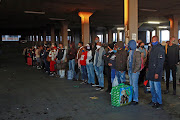 Alexandra residents seen in queues at Pan African taxi rank as most of them go to work for the first time.