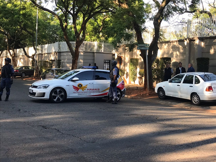 Hawks conduct a raid at the Gupta compound in Saxonwold on 14 February 2018.