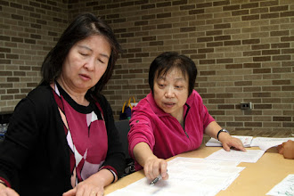 Photo: Hosted 2012 Michigan Chinese Contest. Scene 2. YiWei Deng and YueMing Cheng work at the registration desk.