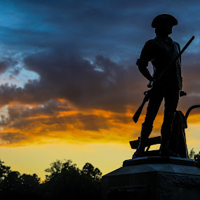 Minute man statue  by Rusty Goris - City,  Street & Park  Historic Districts ( liberty, statue, patriotic, sunset, concord, minute man park )