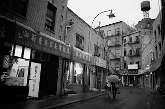 Photo: A rainy evening in Chinatown, New York City.   View the writing that accompanies this post here at this link on Google Plus:  https://plus.google.com/108527329601014444443/posts/DZtYJthkb6G  View more New York City photography by Vivienne Gucwa here:  http://nythroughthelens.com/