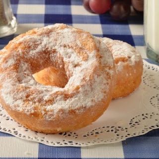 Homemade Powdered-Sugar Coated Cake Doughnuts.
