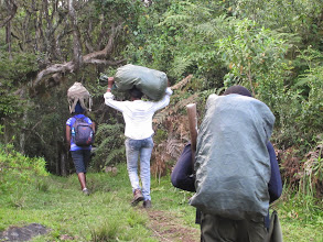 Photo: Porters and Soldier with rifle (to protecgt against buffalo and elephants)