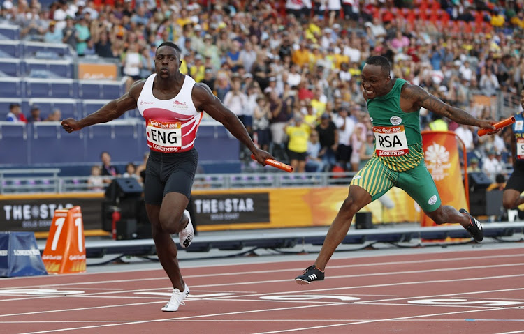 Harry Aikines-Aryeetey of England and Akani Simbine of South Africa run the last leg of the Men's 4x100m Relay at the Gold Coast 2018 Commonwealth Games in Australia on April 14 2018.