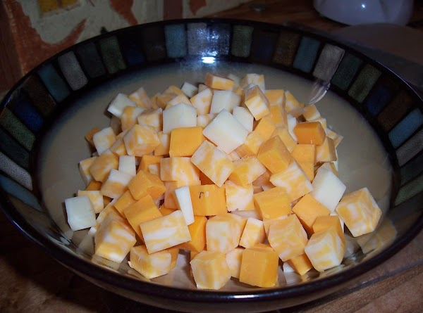 Add cubed cheeses of your choice and finely chopped immitation crab and combine well.  Garnish...