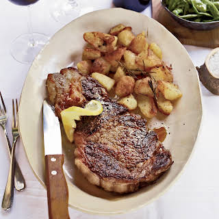 Grilled Rib-Eye Steaks with Roasted Rosemary Potatoes.