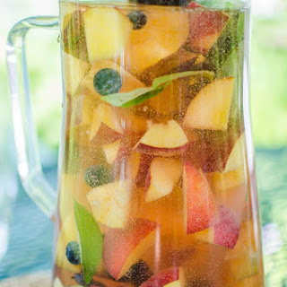 Peach Sangria with Blueberries, Basil and Rose.
