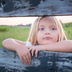 A Penny For Your Thoughts by Angela Moore - Babies & Children Children Candids ( child, sunset, blue eyes, fences, rustic )