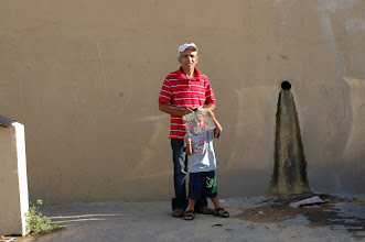 Photo: Sami Kadi, activist, and his son Yousef, next to their home in Shem HaGdolim 6, Jaffa
