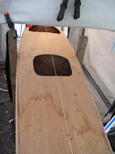 Photo: deck and trim installed, pending final finish, hatch openings handsawn to remove matching grain plywood intact, centre line established for alignment
