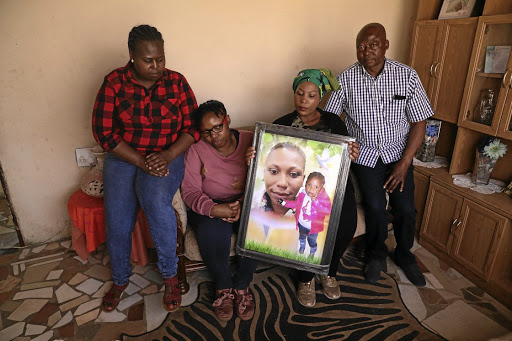 Mantombi, Dineo, Nomthandazo and Themba Rapodile are sad that the sentences of the killer of Nonhlanhla and Hlelokuhle Rapodile (in picture) will run concurrently. /Thulani Mbele