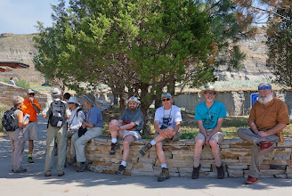 Photo: Field trip participants rest before a long hike into the badlands of the park.