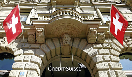 Swiss flags fly beside the logo of Credit Suisse in Zurich, Switzerland. Picture: REUTERS