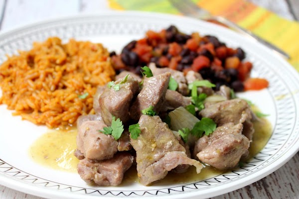 Garnish with chopped cilantro and serve with Spanish rice and refried beans.